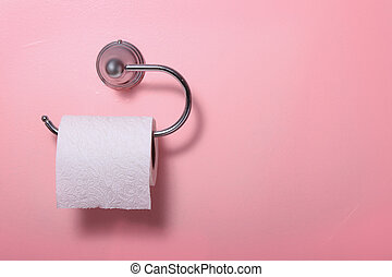 Toilet paper on pink wall - Toilet paper on a pink bathroom...