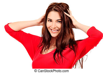 hair care - Portrait of a beautiful young woman in red...