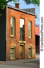 Old Brick Building - facade of a rundown brick building