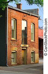 Old Brick Building - facade of a rundown brick building