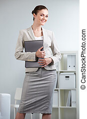 Young employee - Portrait of smiling businesswoman looking...