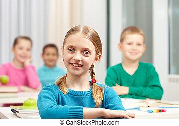 Smart schoolgirl - Cute schoolgirl looking at camera on...