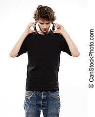 man listening music - studio portrait of a caucasian young...