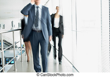 Walking group - Business people walking in the office...