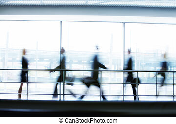 People in motion - Business people walking in the office...