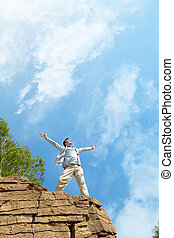 Relaxing man - Portrait of free man standing on cliff with...