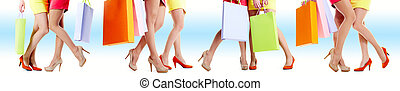 Legs of shoppers - Close-up of beautiful female legs during...