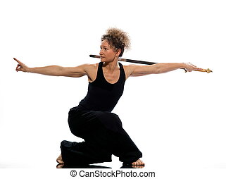 woman tai chi - mature woman praticing tai chi chuan with...