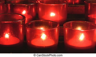 Red church candles - Closeup of red votive candles from a...