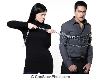 catch me if you can - woman binding his man with a chain on...