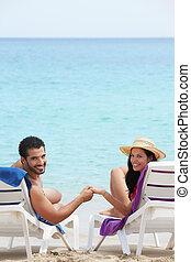 man and woman doing honeymoon in cuba - husband and wife...