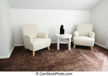 comfortable business lounge, two  armchairs and table