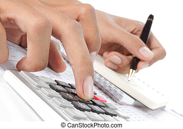 woman's hands with a calculator and a pen. business...