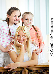 We love mother - Portrait of happy mother being embraced by...