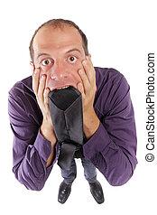 frustred business man biting necktie - frustred business man...