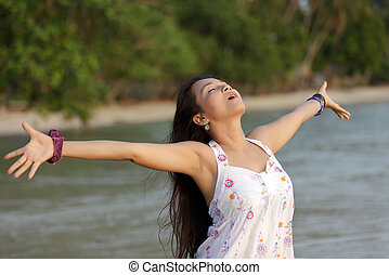 woman breathing in nature - asian woman breathing in...