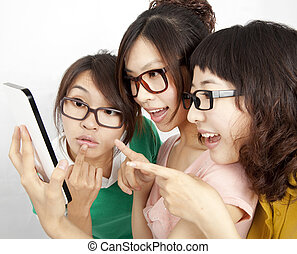 three Students with touch screen tablet computer