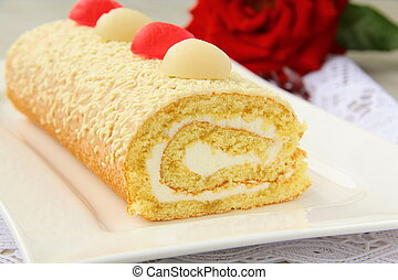 biscuit roulade with cream and white chocolate