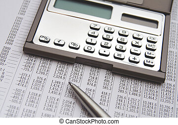 Economist in action - economic sheet, calculator and pen