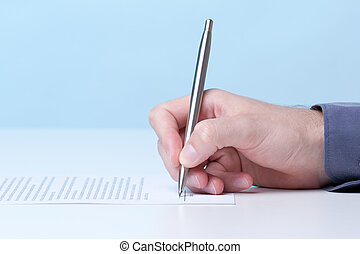 Sign agreement - Signing a contract - hand with pen
