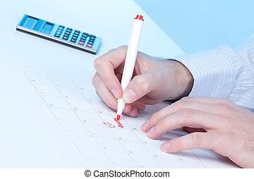 Taxes - Hand write word taxes into calendar
