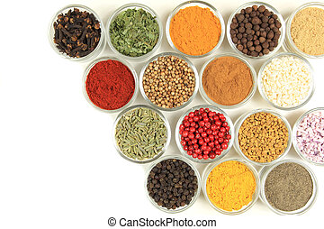 Spices and herbs in small glass bowls. Food and cuisine...