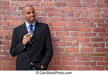 Smiling young business man drinking wine - Smiling young...