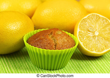 Muffin with lemons - Lemon mufin in green cupcake with whole...