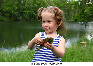fishing - littlle girl with catching fish - fishing - happy...
