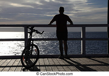 man, bicycle at the pier - man bike at the pier, jetty in...