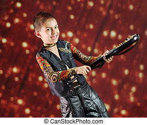 Young Rock Star - A happy elementary rock star weilding his...