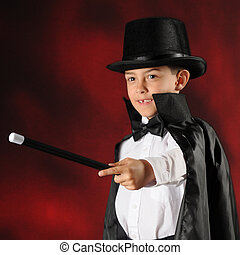 Kazaam - An elementary boy dressed as a magician pointing...