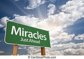 Miracles Green Road Sign Against Clouds and Sunburst