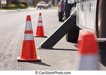Orange Hazard Safety Cones and Work Truck on the Street.