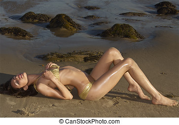 Beautiful woman on beach - Beautiful woman basking in the...
