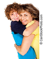Grandmother and grandson hugging each other isolated over...