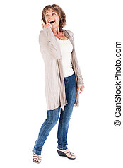 Senior woman pointing upwards and looking away over white...