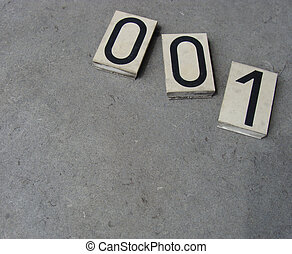 plastic 0 1 zero one number on gray stone surface...