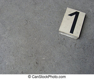 plastic 1 one number on gray stone surface...