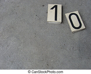 plastic 10 0 1 zero ten one number on gray stone surface...