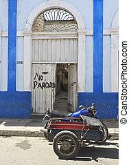 Old motorbike in front of door