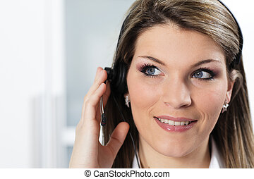young beautiful woman with headset in office
