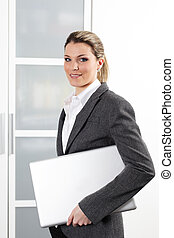 young beautiful woman with laptop in office