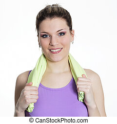 young beautiful woman with towel after sport