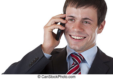 Happy young entrepreneur makes phonecall with cell...