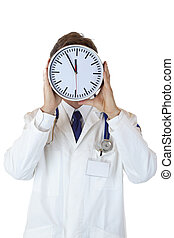 Stressed doctor with clock in front of face as sign of time pressure