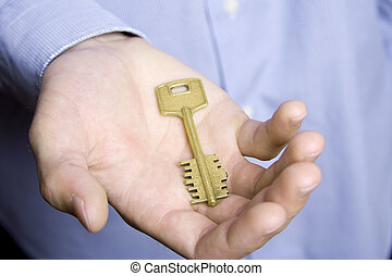 Key on the palm of a man
