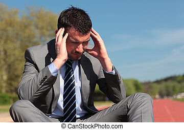 young businessman with head in the hands