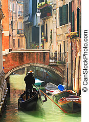 Gondola on canal in Venice, Italy. - Vertical oriented image...
