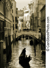 Gondola silhouette on venetian canal. - Gondola silhouette...